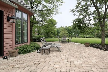Brick patio in suburban home with furniture Stock Photo