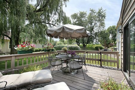 Deck of townhouse with chairs and umbrella photo