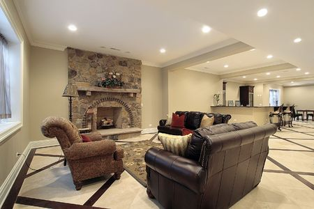 stone fireplace: Basement in new construction home with stone fireplace