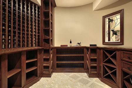 cellars: Wine cellar in luxury home with wood racks
