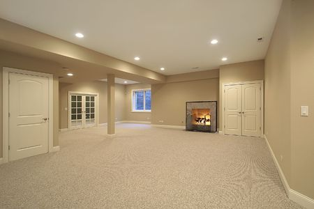 Basement in new construction home with fireplace photo