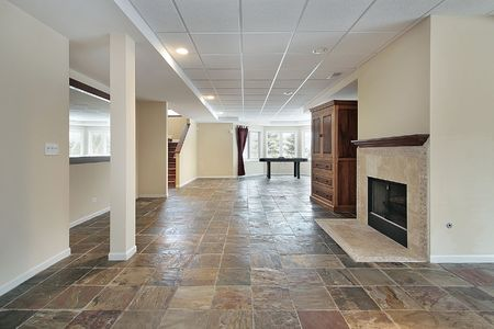 modern sofa: Basement in luxury home with stone floor Stock Photo