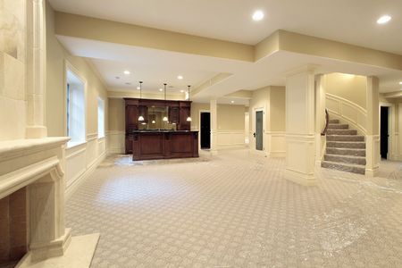 Basement in new construction home with stone fireplace Stock Photo - 6732666