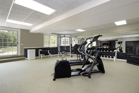 Exercise room in basement of luxury suburban home photo