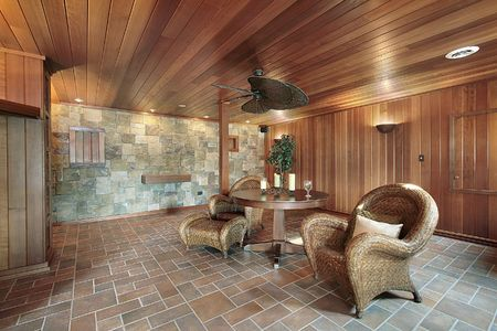 Basement in luxury home with stone and wood walls photo