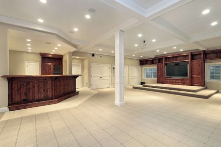 Basement in luxury home with step up TV area photo