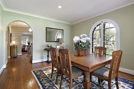 living room interior: Dining room with green walls and arch