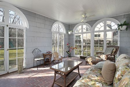 sunroom: Sunroom in luxury home with view to back yard Stock Photo