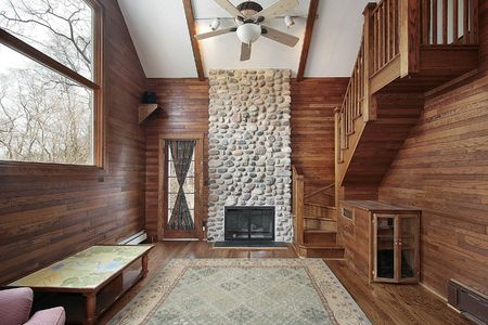 Wood paneled family room with stone fireplace Stock Photo - 6733478