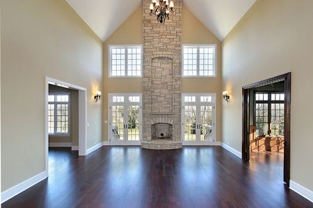 Family room in new construction home with two story stone fireplace Banque d'images