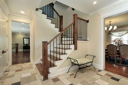 entryway: Foyer in new construction home with view into dining room Stock Photo