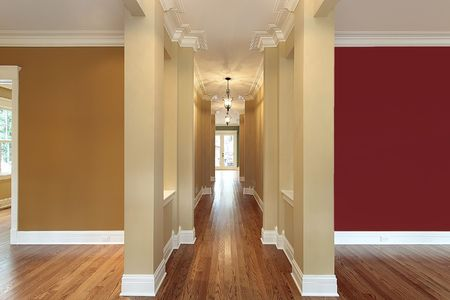 Foyer in new construction home with colorful walls photo