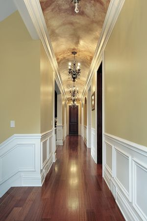 entryway: Hallway with chandeliers in luxury suburban home