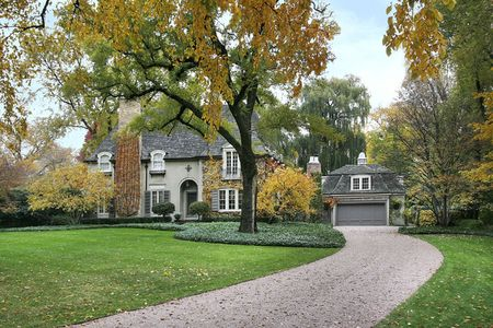 Luxury home with large yard in autumn Stock Photo