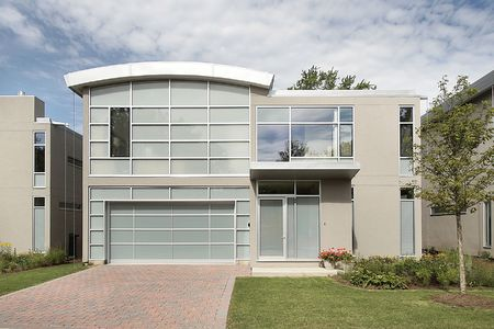 contemporary: Front view of new modern luxury home Stock Photo