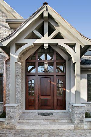 large doors: Entry way with brick walkway and wood doorway