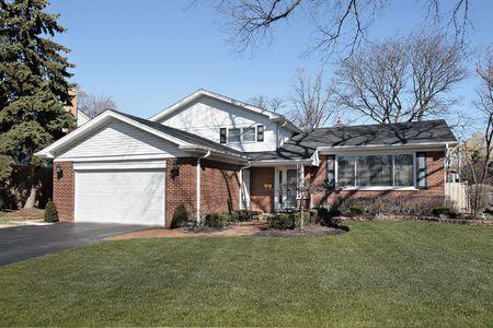 Suburban brick home with orange walkway Stock Photo - 6761077