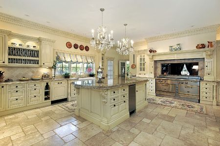 Traditional kitchen with large island and stove photo
