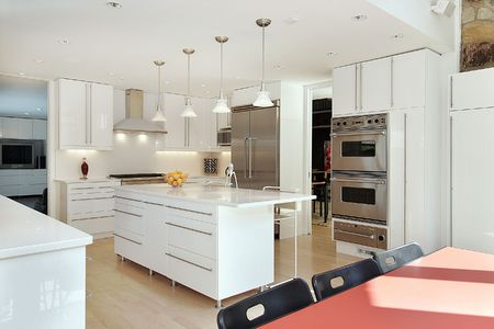 fixtures: Kitchen in luxury home with white cabinetry Stock Photo
