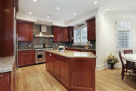Kitchen with wood cabinets with view into eating area photo