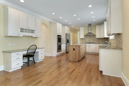 eating area: Kitchen with white cabinets and eating area