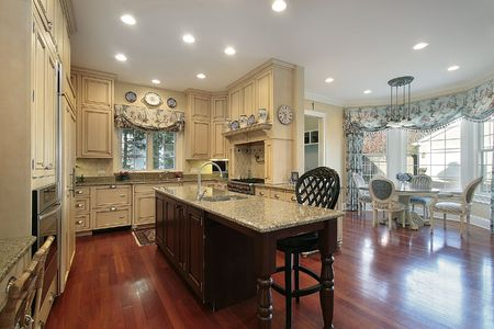 eating area: Kitchen with wood cabinets and eating area