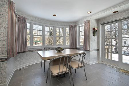 eating area: Eating area near kitchen with curved windows Stock Photo