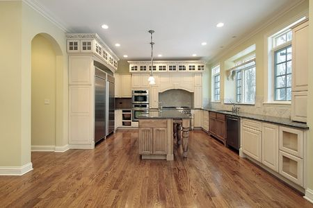 Kitchen with light wood cabinets and island photo