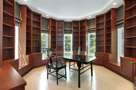 Library in new construction home with wood cabinetry