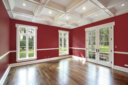 Library in new construction home with red walls
