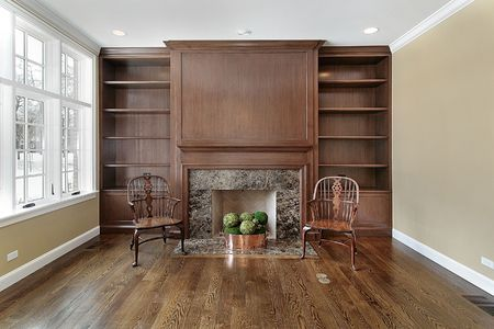 Library in new construction home with fireplace