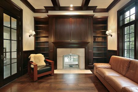 Library in luxury home with marble fireplace photo