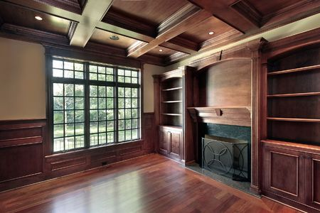 Library in new construction home with marble fireplace photo