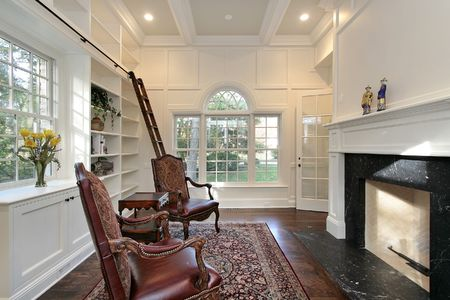 Library in new construction home with fireplace photo