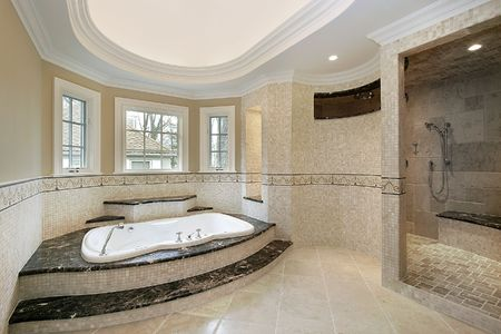 Master bath in new construction home with marble steps photo