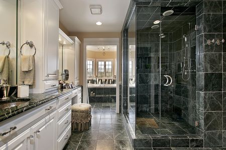 master: Master bath in luxury home with black glass shower