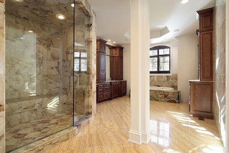 Master bath in new construction home with marble shower Imagens