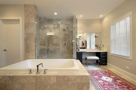 Master bath in luxury townhouse with glass shower photo