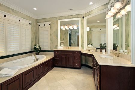 cabinetry: Luxury master bath with cherry wood cabinetry Stock Photo