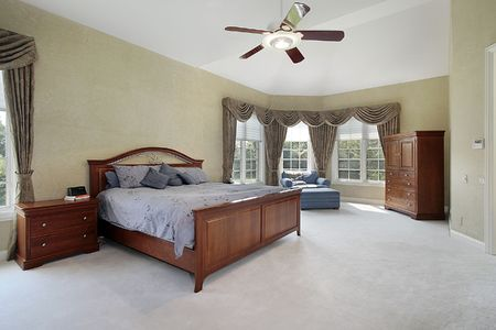Master bedroom in luxury home with wall of windows Stock Photo - 6733532
