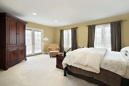 Master bedroom in luxury home with door to balcony Stock Photo - 6733204