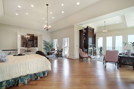 sitting area: Master bedroom in luxury home with sitting area Stock Photo