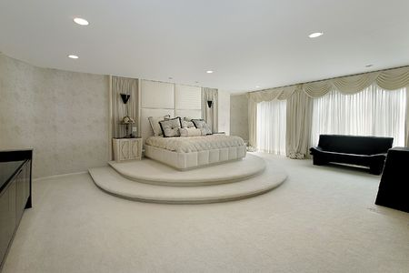 Master bedroom in luxury home with step up bed area Stock Photo - 6732931