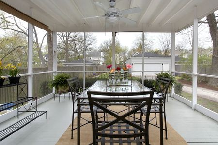 screened: Screened in porch with table and wood floor