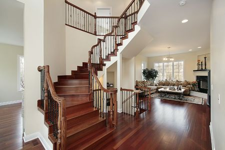 Foyer in luxury home with cherry stairway photo