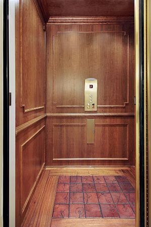 residence: Elevator with floor design in luxury home
