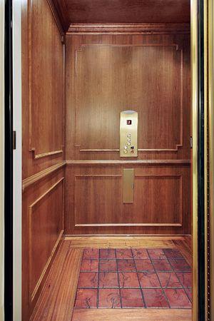 elevator: Elevator with floor design in luxury home