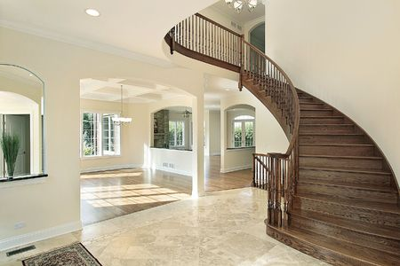 luxuries: Foyer in new construction home with circular staircase Stock Photo