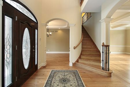 residence: Foyer in new construction home with stain glass door Stock Photo
