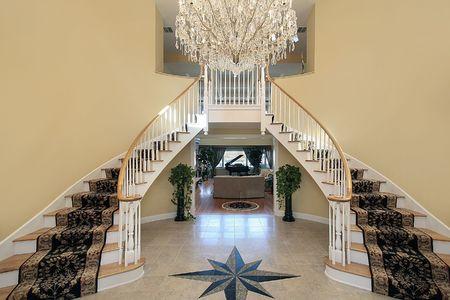 home lighting: Foyer in luxury home with floor design Stock Photo